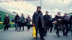Slow motion crowd of people on the platform of suburban railway station Stock Footage