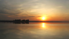 Sunset on a river with island Stock Footage