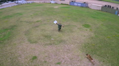 Aerial view above a K9 dog in training attacking trainer. Stock Footage