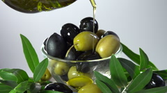 Green and black olives poured with olive oil Stock Footage