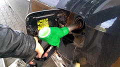 Refueling 95e10 gasoline in a cars tank Stock Footage