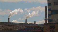 Smoking Chimneys at a Factory - stock footage