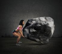 Stock Photo of Power of muscular woman