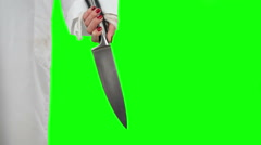 Knife in hand girl on a green background Stock Footage