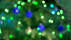 Multi-colored lights flashing on the Christmas tree. not in focus. Stock Footage