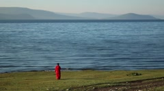 Stock Video Footage of Siberian Lake with traditional Mongolian dress