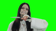 Girl with a demonic face of attempts to cut a Gorgo. Shooting on Chroma key - stock footage