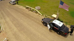 Aerial view above a K9 dog in training in a mock shootout between police and Stock Footage