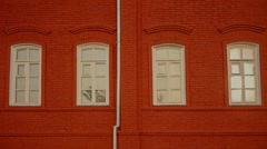White windows in red brick wall Stock Footage