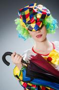 Clown with umbrella in funny concept Kuvituskuvat