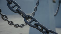 massive chain links, fence embankment - stock footage