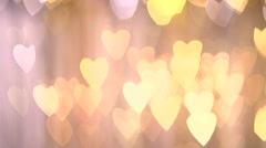 Abstract motion background. golden bokeh in the form of heart. Stock Footage