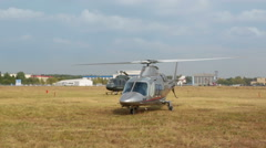 Italian Agusta A109S Grand helicopter warms the engine before the flight - stock footage