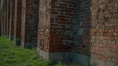 background, brickwork, wall, green grass, Passage camera bottom to top - stock footage