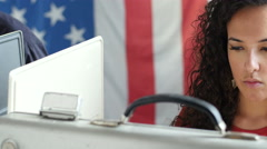 Young woman voting in a voting booth, close up Stock Footage