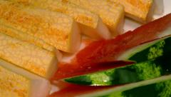 4k – Pieces of juicy ripe watermelon and melon on plate 01 Stock Footage
