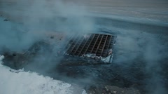 Hot water flows into storm sewers Stock Footage