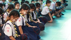 Scout seats Saluting, Scout Camp in Pieamsuwan school Bangkok Thailand. Stock Footage