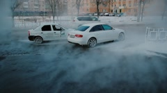 Hot water flowing carriageway, car collision Stock Footage