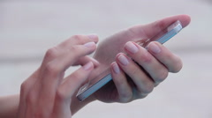 Close-up of woman's hands with nice manicure texting, messaging on smart phone - stock footage