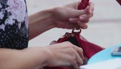 Woman looking for something in purse, mess in bag, pickpocketing, accessories Stock Footage