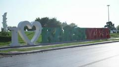 """I love Karsiyaka"" sign at seaside, front of traffic. Stock Footage"