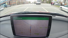 A car driver using a Google Navigator application on Android device Samsung Stock Footage