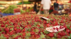 Fresh strawberries on market at the biggest and most crowded bazaar in the city. Stock Footage