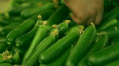 Fresh green cucumber collection outdoor at Bostanli bazaar in Izmir. Stock Footage