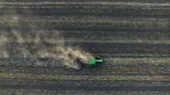 Aerial: Tractor plowing the soil. Top view. Stock Footage
