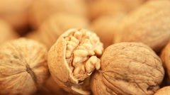 Walnut kernels and whole walnuts at bazaar in Bostanli - Karsiyaka, Izmir. Stock Footage