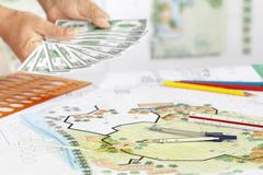 Earning for design landscape plan, or any other project. Stock Photos