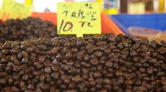 Black olives on market at the biggest and most crowded bazaar in Izmir. Stock Footage