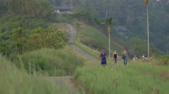 Man jogging on the ridge walk path,Ubud,Bali,Indonesia Stock Footage