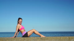 Stock Video Footage of Woman doing sports exercises outdoors by seaside 4K
