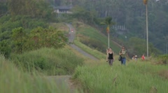 Tourist couple walking on ridge path,Ubud,Bali,Indonesia Stock Footage