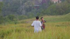 Indonesian tourists make photo between high grass,Ubud,Bali,Indonesia Stock Footage