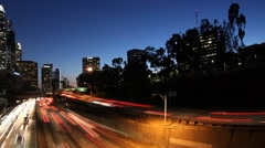 Time Lapse of LA Downtown & Freeway Los Angeles at night Stock Footage