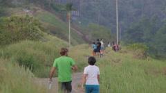 Backside of tourists walking on the ridge,Ubud,Bali,Indonesia Stock Footage