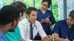 4K Portrait of smiling young medical worker in a team meeting - stock footage