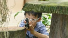 Boy playing with toy gun Stock Footage