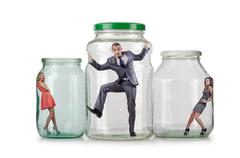 People trapped in the glass jar Stock Photos