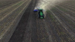 Aerial: Tractor plowing the soil on sunset Stock Footage