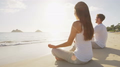 Meditation yoga people by the sea relaxing serene Stock Footage