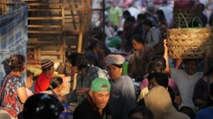 Busy scene at market with basket on head,Ubud,Bali,Indonesia Stock Footage