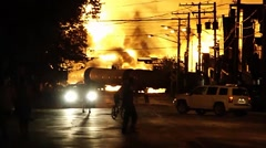 Burning oil from railway cars laying in residential street - stock footage