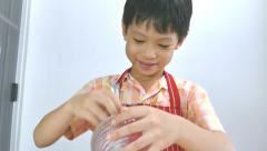 Boy putting ingredients on pizza Stock Footage