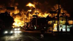Power poles and city lights blinking during catastrophic disaster Stock Footage