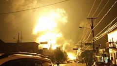 Large mushroom shaped explosion rising above city after train crash Stock Footage
