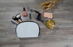 Decorative cosmetics with wood background - stock photo